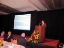 マカオの投資環境についてプレゼンを行うIPIMの吳旭輝氏 (c) IPIM 貿易投資促進局