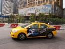 宏益電召有限公司が運営する黄色い車体の無線タクシー―本紙撮影