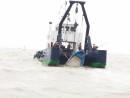 転覆した蛇頭の密航ボートはマカオ当局により回収済み=2月27日、マカオ・コロアン島沖(写真:DSAMA)