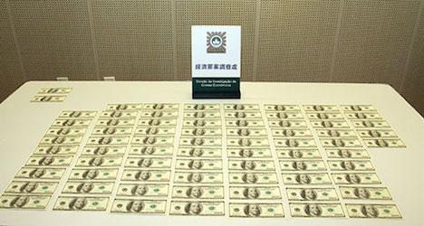 マカオで偽100米ドル紙幣使用の中国人教師逮捕=75枚を空港の旅行社に持ち込み両替
