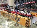 マカオ国際空港出発フロアに設置された佐藤琢磨選手の優勝マシン(写真:CAM)