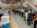 あべのタスカルの倉庫を訪問するマカオ政府視察団(写真:IAS)