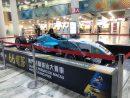 マカオ国際空港出発フロアの非制限エリアに設置されたダニエル・フンカデラ選手の優勝マシン(写真:CAM)